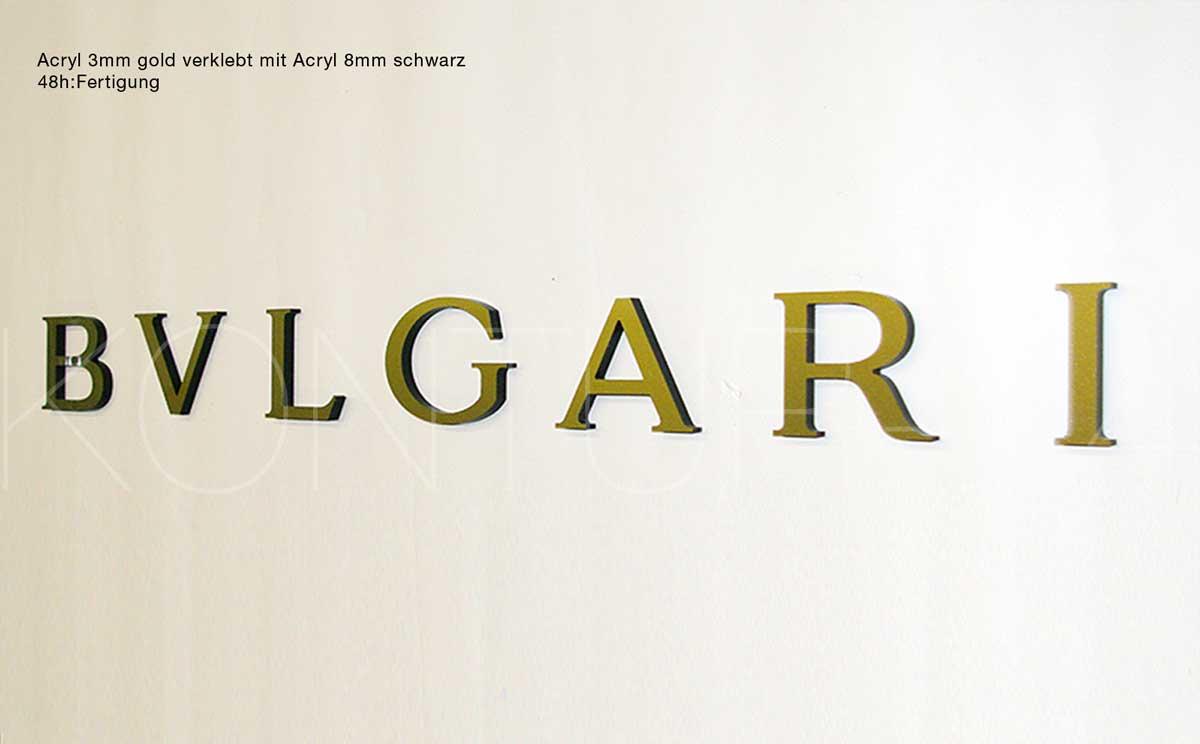 3D Acrylbuchstaben 3mm gold verklebt mit 8mm schwarz / gefräst in 48h:Fertigung