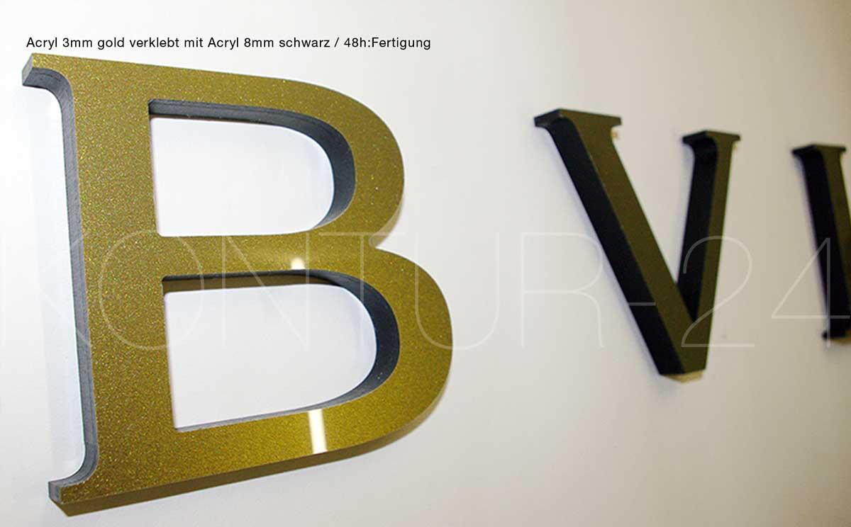 Detail Acrylbuchstaben 3mm gold verklebt mit 8mm schwarz